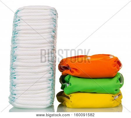 A large stack of disposable diapers reusable corresponds to several isolated on white background