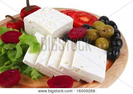 white cheese served on plate with vegetables