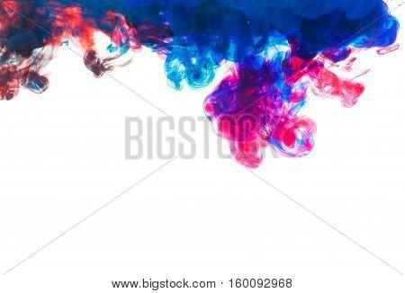 Color drop underwater creating a silk drapery. Ink swirling underwater. Cloud of colorful ink