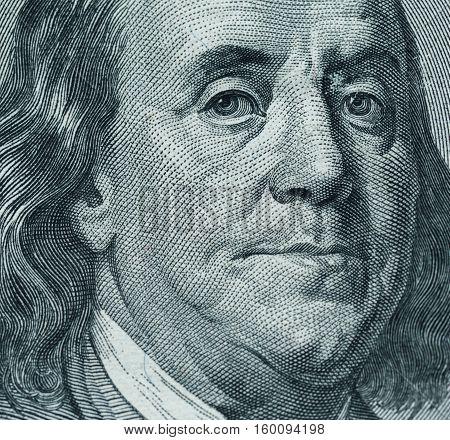 Dollars closeup. Benjamin Franklin's portrait on one hundred dollar bill