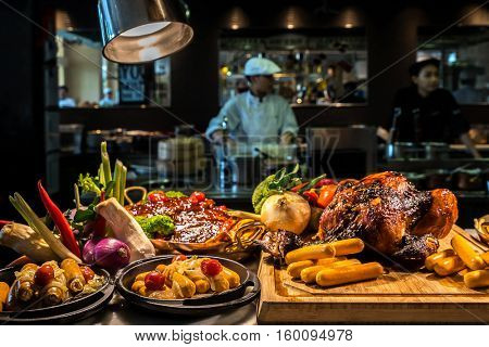 Food station with grilled carving food with kitchen working background