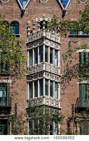 Details of interesting triangular decorated balconies in Barcelona, summer Spain