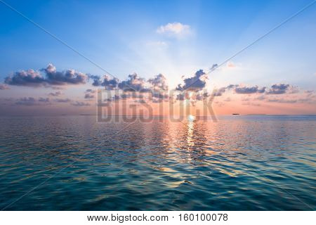 Sunset over the ocean. Maldives. Indien ocean.