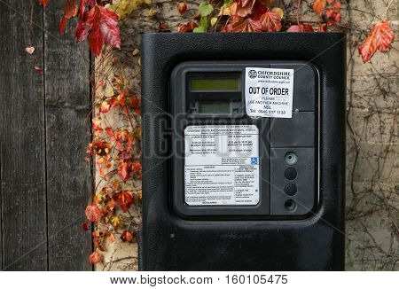 Broad Street Oxford United Kingdom December 04 2016: Oxford parking meter with Out of order notice sticker and additional hand written notice on Broad Street Oxford.