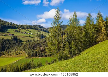 Farm in Dolomites, Val de Funes valley. Picturesque green alpine meadows of the valley