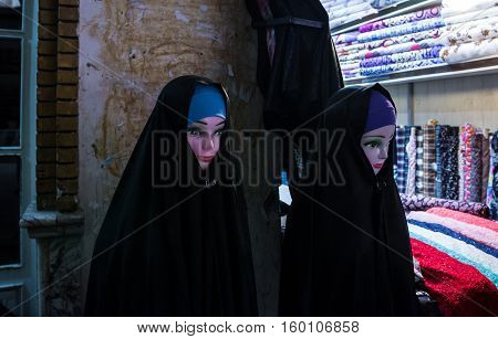 chador on a mannequins in textile store on a bazaar in Kashan Iran