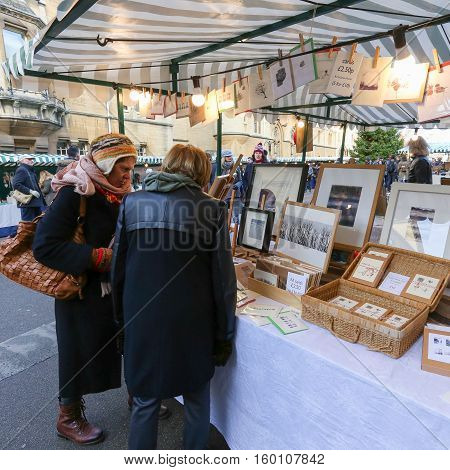 Broad Street Oxford United Kingdom December 04 2016: Arts and Crafts Market with open stalls on Broad Street craft market stall with art prints and cards Oxford.