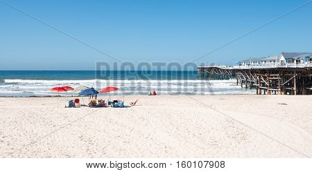 Relax on the white sand beach under colorful umbrellas ocean coast