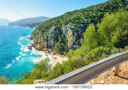 Scenic road on coast of Sardinia island with view of Porto sa Ruxi beach, Sardiniia, Italy