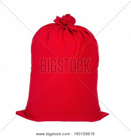 Red tied up closed Christmas sack of Santa Claus full of gifts isolated on white background