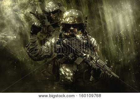 Green Berets US Army Special Forces Group soldiers in the jungle