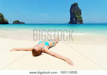 Young Woman Relaxing On Tropical Beach