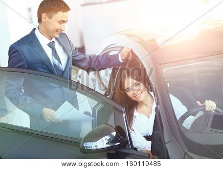 business woman chooses a car in the office