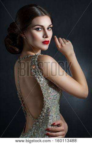 Beautiful Young Woman In An Evening Dress Crystal. Perfect Beauty, Red Lips, Bright Makeup. Twinklin