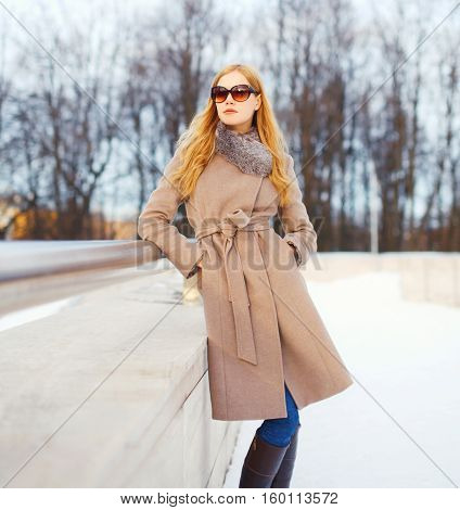 Fashion Beautiful Young Blonde Woman Wearing A Coat Jacket And Sunglasses In Winter City