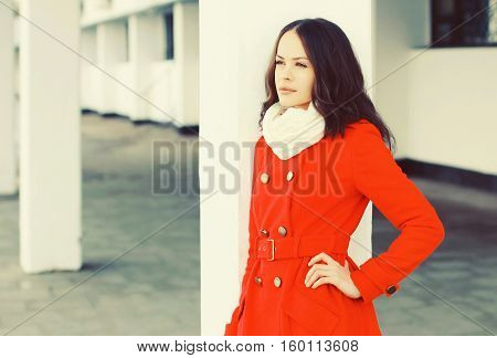 Fashion Beautiful Young Woman Wearing A Red Coat Jacket And Scarf In Winter City