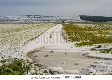 RURAL LANDSCAPE WINTER. Alta Murgia National Park: snowy hills.-(Apulia) ITALY-It is a limestone plateau,with wide fields and rocky outcrops,grassland characterized by sheep paths,ancient carob tree.