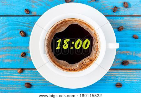 It's eighteen o'clock already. Time to finish work and go home or have supper. An image of a top viewed coffee cup with clocks face showing 18:00 pm.