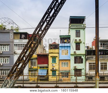 Typical colorful houses in the city center of Hanoi, Vietnam - View through Long Bien Bridge