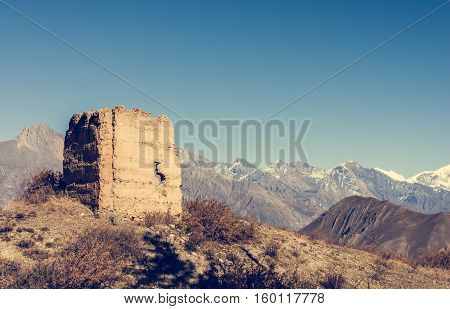 Ancient watch tower with mountain scenery. Dhaulagiri, Nepal