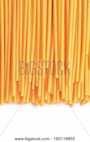 raw spaghetti bucatini pasta studio isolated closeup