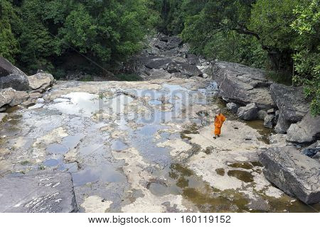 Monk Visiting Kep Waterfall Near Kep In Cambodia
