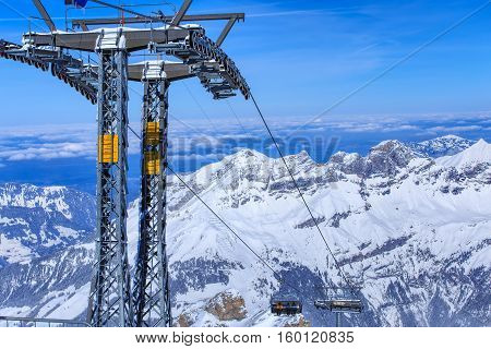 Mt. Titlis, Switzerland - 9 March, 2016: the Ice Flyer chair lift. Mount Titlis is a mountain of the Uri Alps, located on the border between the Swiss Cantons of Obwalden and Bern, mainly accessed from the town of Engelberg on the north side.