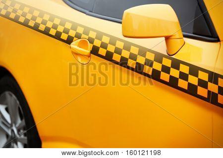 Yellow taxi cab, closeup. Taxi service concept.