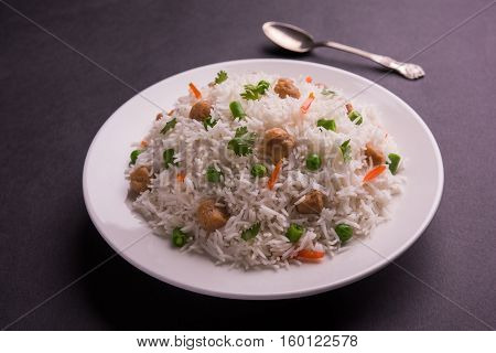 Yummy soya pulao or pilav or pulav or rice or soyabean chunk fried rice with peas and beans, indian or pakistani cuisine