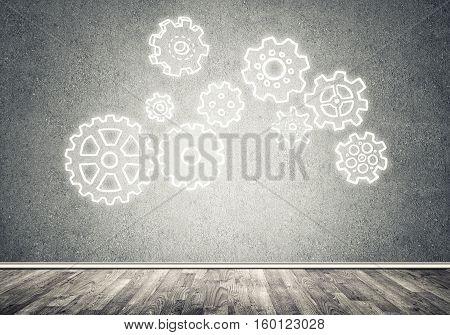 Gear hand drawn mechanism on gray wall
