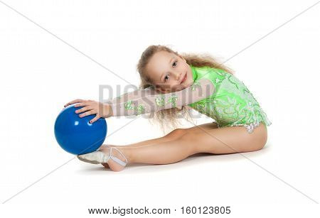 Gymnast Cute Little Girl Sitting On The Floor. The Child In The Gymnastic Suit With A Blue Ball In H