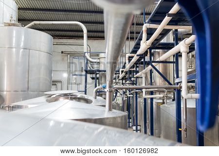 Horizontal photo in color of pipelines in a distillery in a alcoholic beverage factory