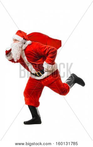 Santa Claus running at New Year or Christmas delivery rush with gift bag full of presents on white background