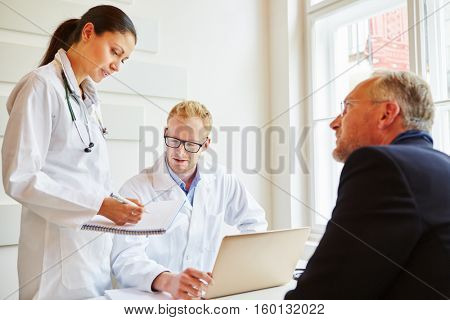 Doctors and patient talking about therapy