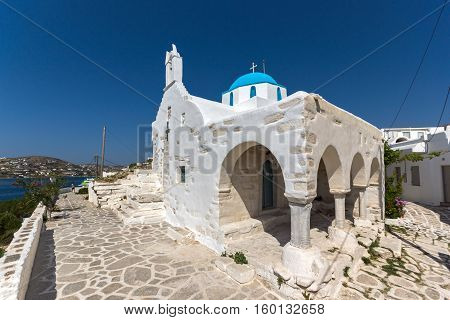 White chuch with blue roof in town of Parakia, Paros island, Cyclades, Greece