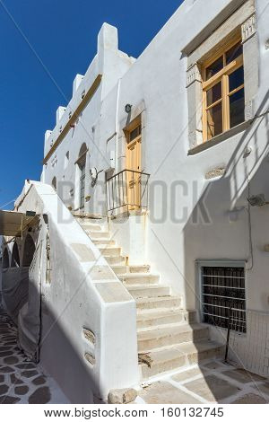 white houses with flowers in town of Parakia, Paros island, Cyclades, Greece