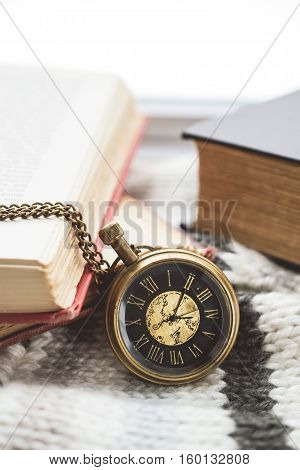 Pocket Watch with Old Books on Scarf in Vintage Tone
