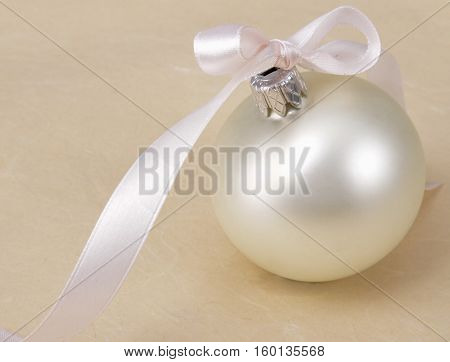White christmas ball , isolated on beige background.