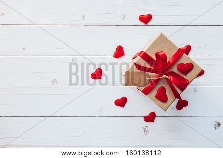 Top View (above) Gift Box And Red Ribbon And Red Heart For Valentine On Table Wooden. Valentine Back