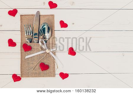 Table Set For Celebration Valentine's Day. Wooden Table Place Setting And Silverware With Red Heart