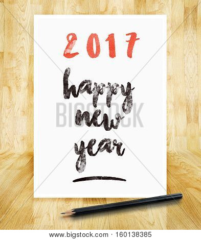 2017 Happy New Year On White Paper Frame With Pencil In Hand Brush Style In Wood Parquet Room,holida