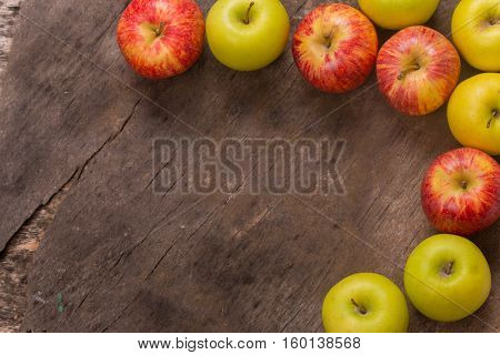 apples on a old wooden table, studio picture, with copy space. Free space for text