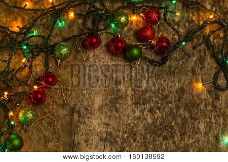 Christmas decoration with lighting, on an old wooden background