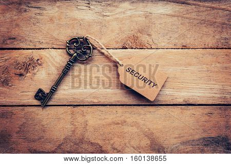 Business Concept - Old Key Vintage On Wood With Tag Security.