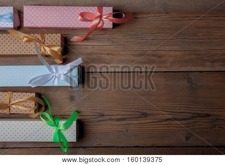 top view of colored gift boxes on old wooden background
