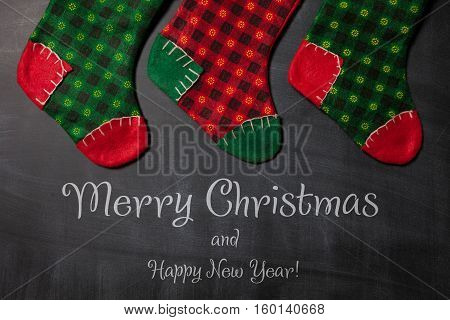 Colored Christmas stocking on a blackboard background