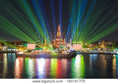 Bangkok new year countdown lighting effects and laser show at Wat Arun Temple in the night time Bangkok Thailand