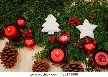 Christmas decorations with red candle -wooden board