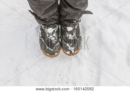 Top View Of Feet In Boots And Gaiters Snow Protection In The Snow.