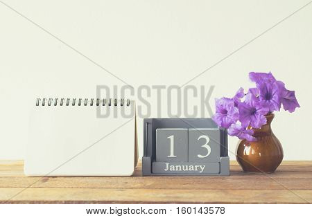 Vintage Wood Calendar For January Day 13 On Wood Table With Empty Note Book Space For Text.